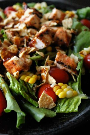 The Leftover BBQ Salad    Pile of Romaine Lettuce   Handful of cherry tomatoes   1 leftover ear of corn   3 oz leftover grilled chicken breasts cut up   3-4 baked tortilla chips crumbled (7g)   1/2 tbsp BBQ sauce   1/2 tbsp Worcestershire Sauce