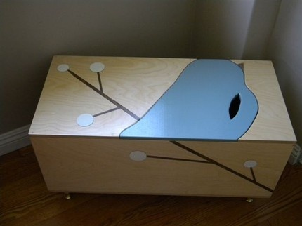 """Maude Toy Box with Book Cubby : Lift off the bird to access the to bin. An open book cubby is on the other end. Made of Baltic Birch Ply and non toxic paing. 30 x 14 x 15.5"""". Available with legs or casters. Custom order. $495."""