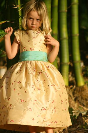 Gold flower girl dress embroidered with flowers and green sash. jr bridesmaid dress designed by littleeglantine.com #flowergirl .