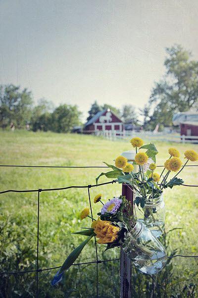 Yellow Wedding Flowers in jars