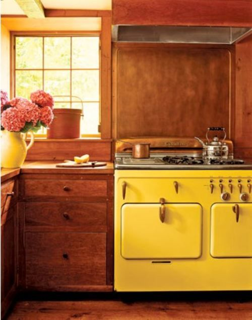 lemon yellow Chambers stove, rustic cabinetry