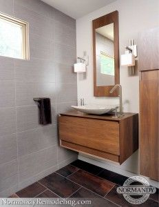 The floating vanities are perfect for a modern bathroom design.  Created by Normandy Designer Chris Ebert