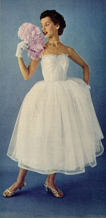 Model wearing a white tulle gown, 1950s.