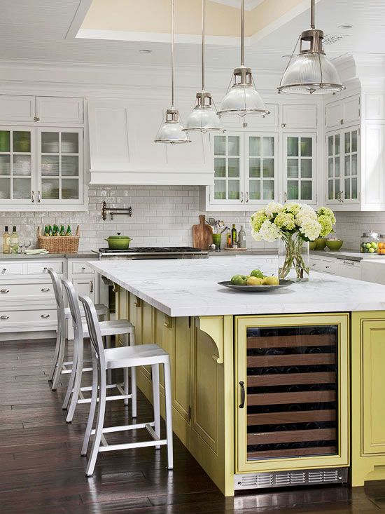 Add color to an all-white kitchen with a painted island. More remodeled kitchens: www.bhg.com/...