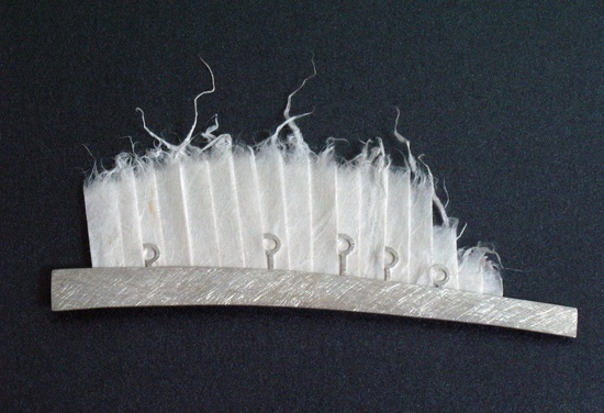 Arturo Claudett - Brooch. Silver and Chinese handmade paper.