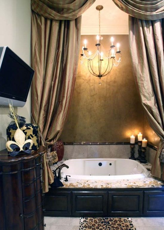 curtains in front of tub; chandelier over tub