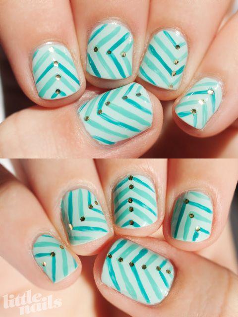 cute aqua zig zag nails with gold glitter accents!