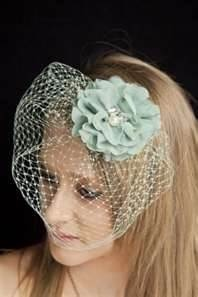 Veiled wedding fascinator with a mint green flower