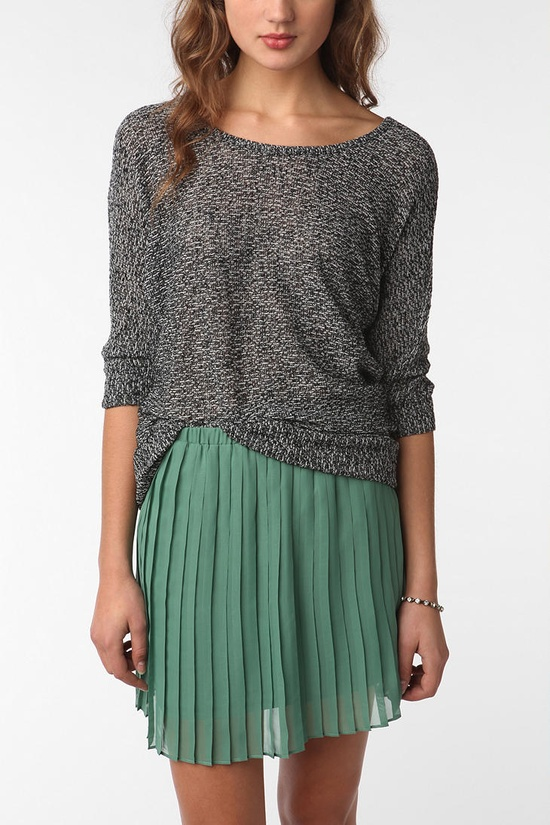 Light sweater and pleated skirt.