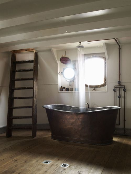 super cute bathroom except i would have the ladder as a towel rack or somethin not go up to a secret room in the bathroom...lol