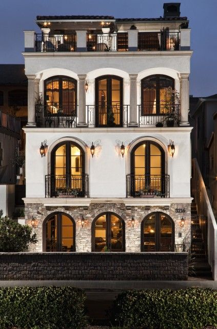 Love this exterior: the balconies on every level with the rooftop patio, the white walls with black accents, love it.