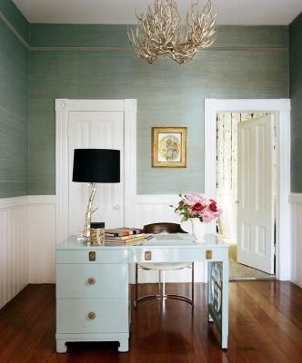 gray blue silk walls with white chair rails and molding, antler chandelier