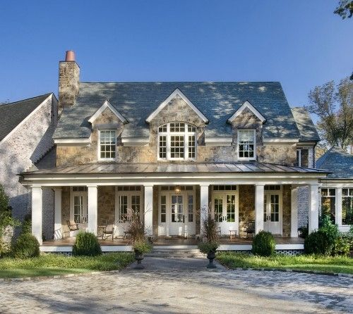 Love the exterior....dormers, stone, columns, and veranda