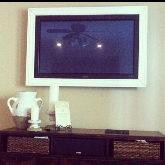 DIY: Use crown molding to frame your wall-mounted flat screen TV!