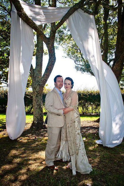 love the makeshift arch with the cloth on the tree branches