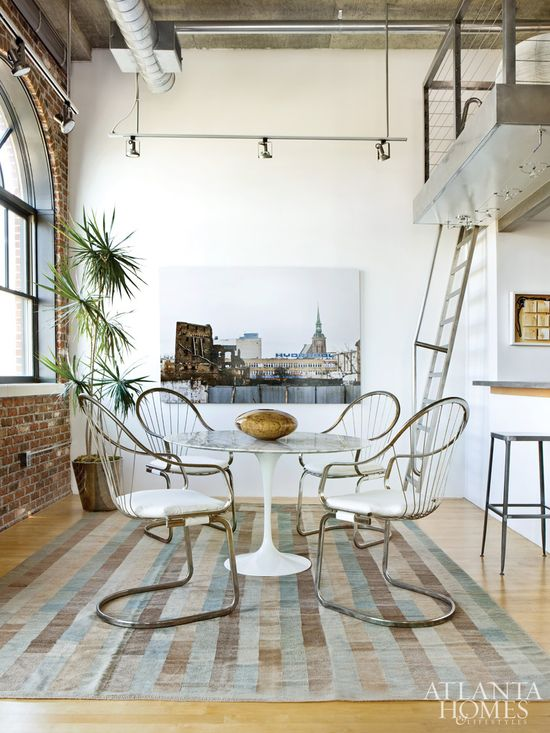 A classic mid-century Saarinen dining table and four metal armchairs from Foxglo