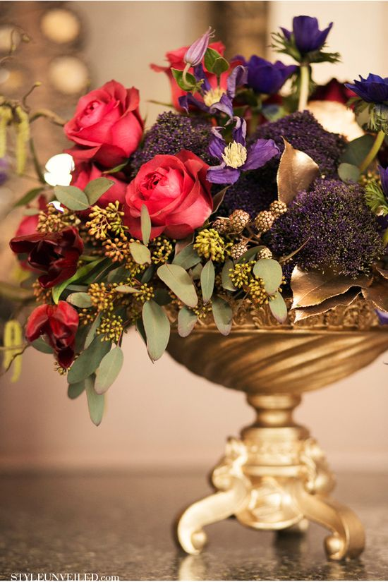 Gold urn; fresh flowers with painted leaves