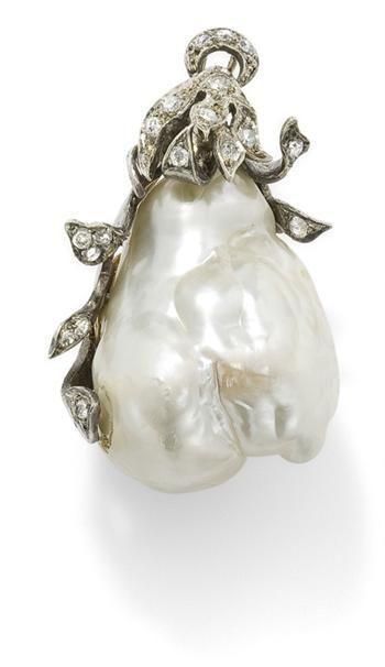 A baroque cultured pearl and diamond pendant.