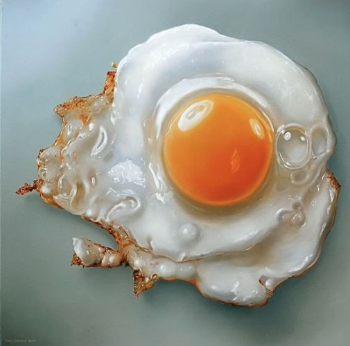 The focal point is the yolk of the egg due to the orange and the dual background.