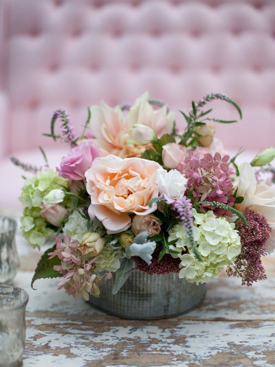 Beautiful centerpiece in shades of lavender, peach and cream.