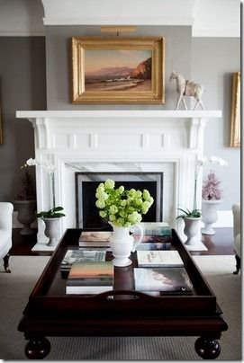 Love the gray walls with white trim that make this mantel pop.