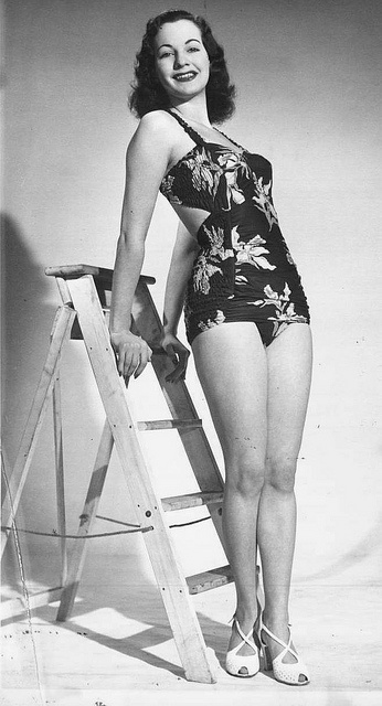 A flirty cutout in the back adds extra sizzle to this charming1930s floral print swimsuit. #summer #vintage #fashion #1930s