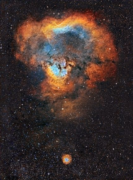 At top sits the emission nebula known as Cederblad 214, which is part of a larger star-forming complex called NGC 7822. The dot at bottom is a smaller nebula called Sharpless 170. The entire piece of punctuation spans about 40 light-years in the constellation Cepheus.