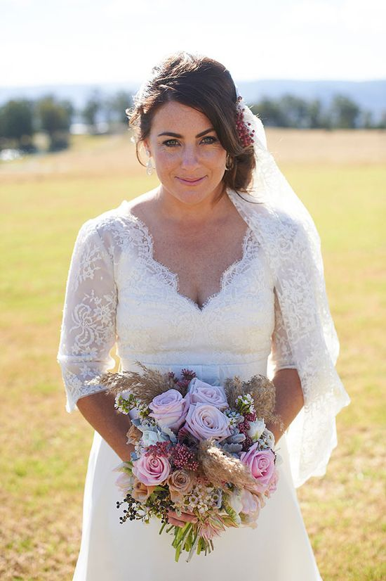 bride in 3/4 length lace sleeves & gorgeous pink rustic bouquet