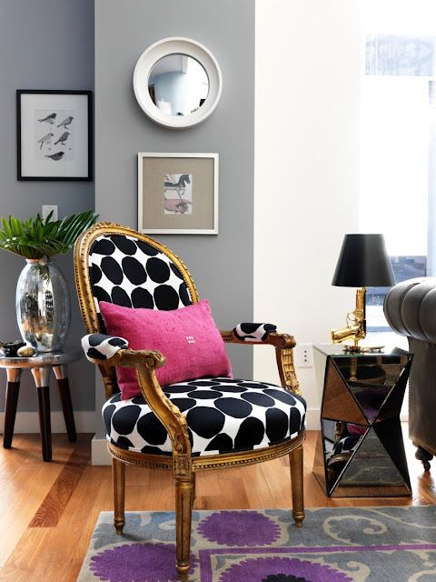 Black and white polka dots on an antique chair.