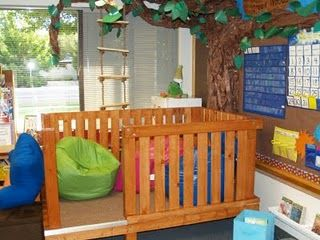 """The Magic Tree House"" ... fun reading corner loft built on the ground level to be safer.  (Notice the rope ladder and tree... too cute.)"