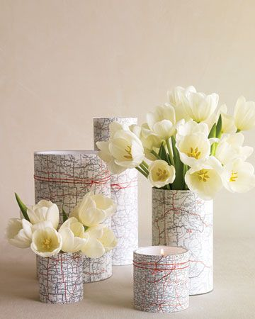 Recycle maps to make unique centerpieces: Cut charts to fit around cylinders of various heights, then attach them with double-stick tape and fill each with flowers or a candle.