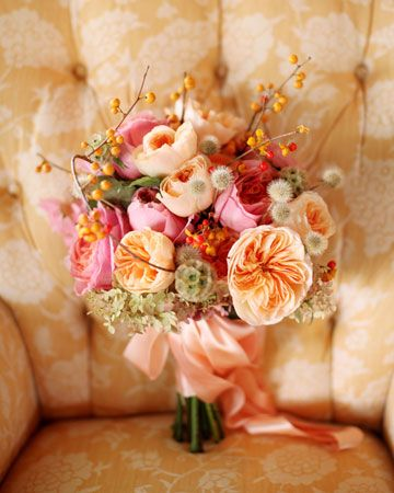 Pink-and-Peach Bouquet - Traditional and alternative elements are artfully combined in this arrangement of garden roses, paniculata hydrangeas, bittersweet, and scabiosa pods.
