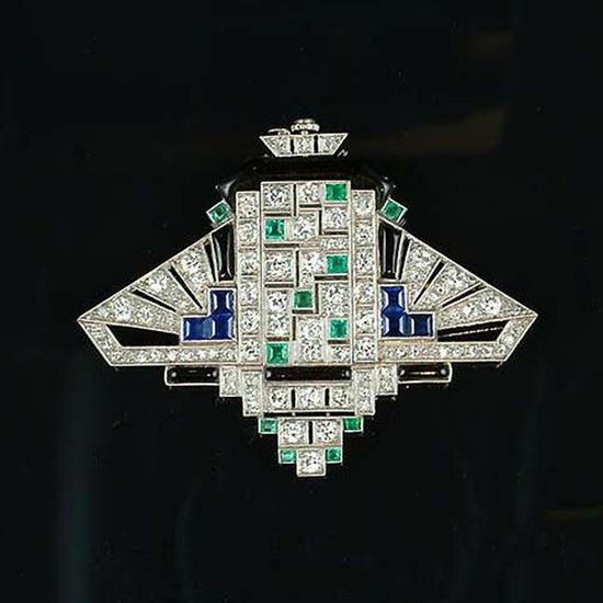 Art deco gem-set and diamond lapel watch, circa 1925.