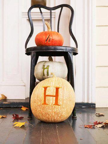 monogram pumpkins on porch.