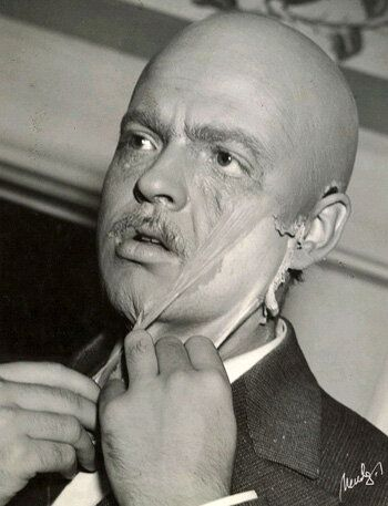 Orson Welles taking off his Citizen Kane face