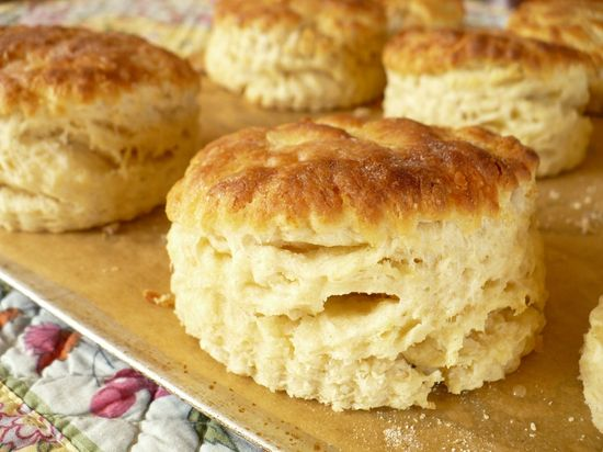 BUTTERMILK BISCUITS    Recipe from chef, Scott Peacock courtesy of The New York Times    Making your own baking powder by combining fresh cream of tartar and baking soda will produce biscuits with the most lift. Don't be afraid of the hot oven temperature either as this will allow the heat to get on the biscuits quickly and sufficiently brown their tops. When forming the dough, mix in the buttermilk until the mixture just holds together. The last thing you want to do in this recipe is overwork the dough and ruin the biscuits flaky, buttery texture.    INGREDIENTS:    1 tablespoon cream of tartar  1 1/2 teaspoons baking soda  5 cups sifted unbleached all-purpose flour, plus more as needed  1 tablespoon plus 1 teaspoon kosher salt  1/2 cup plus 2 tablespoons packed lard or unsalted butter, chilled and cut into pieces  2 cups chilled cultured buttermilk, plus more as needed  3 tablespoons unsalted butter, melted  METHOD:    Place a rack in the upper-middle position of the oven and preheat to 500°.  Make your own baking powder by sifting together the cream of tartar and baking soda.  In a large bowl, whisk together the salt, baking powder and salt. Add the lard or butter and quickly work the pieces into the flour with a pastry cutter or the tips of your fingers. The pieces should be coarsely blended and resemble large peas.  Make a well in the center of the bowl and pour in the buttermilk. Quickly mix the ingredients until the mixture just comes together and forms a shaggy mass. Add 1-2 more tablespoons of buttermilk if the mixture seems dry.  Immediately turn the dough out onto to a generously floured surface and quickly knead the dough about ten times until a ball forms. Gently flatted the dough and use a lightly floured rolling pin to roll the dough out a thickness of 3/4 inch.  With a fork that has been dipped in flour, pierce the dough at half inch intervals before using a fluted, 2 1/2 or 3 inch biscuit cutter to stamp out the biscuits. When you have run out of ro