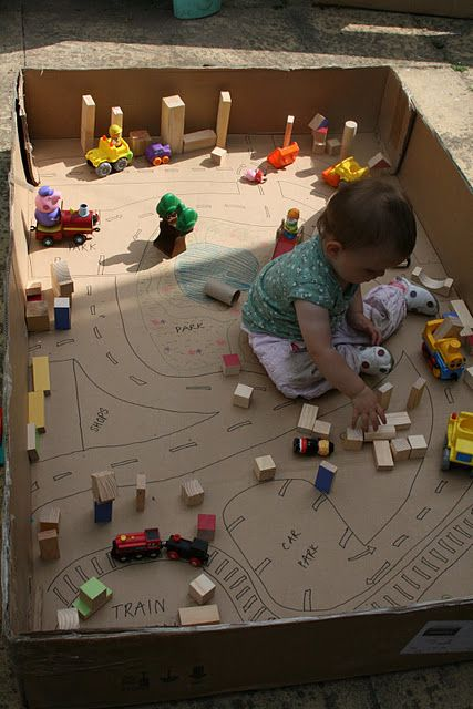 Block land with roads in big empty cardboard box from the Imagination Tree blog!