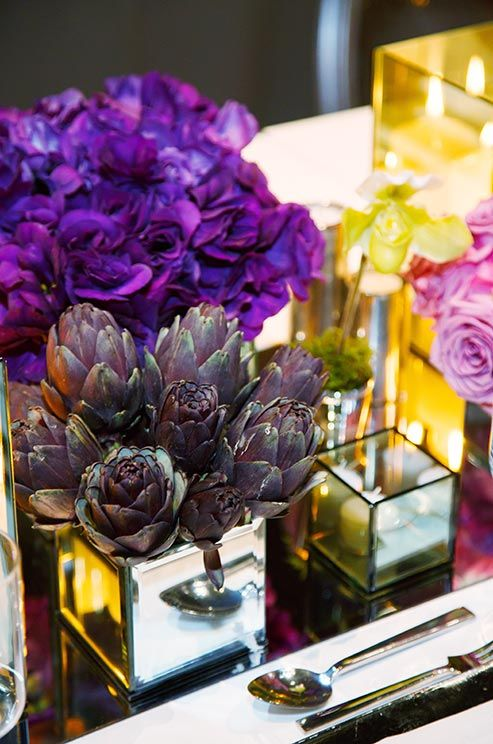 Purple artichokes are a playful alternative to flowers, especially when combined with pink roses and purple lisianthus.