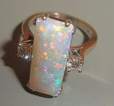 An Exceptional Opal & Diamond Ring, 14K White Gold - Vintage from luxury on Ruby Lane Not oft found, this White Coober Peddy Australian Precious Opal is cabochon cut in the form of a lozenge - and decidedly one of the nicest Opals I've seen!  In a clean and understated mount, the Opal is flanked on each side with a  .15 carat brilliant cut, An Exceptional Opal & Diamond Ring  14K White Gold - Vintage, Antique & Vintage Jewelry, Vintage, Fine Opal & Diamond Rings