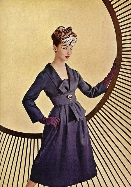 Very elongated cat's eye liner, a quirky pointed tiger fur hat, and gorgeously elegant inky purple dress. Fabulous! #vintage #1950s #fashion #hat #dress #gloves