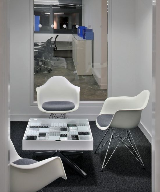 ColArts New Multifunctional London Offices, designed by Morgan Lovell - love the display table! Herman Miller Eames chairs