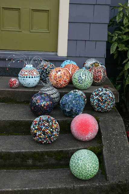 Re-claimed glass on used bowling balls.... Presto!  Garden Mosaics!