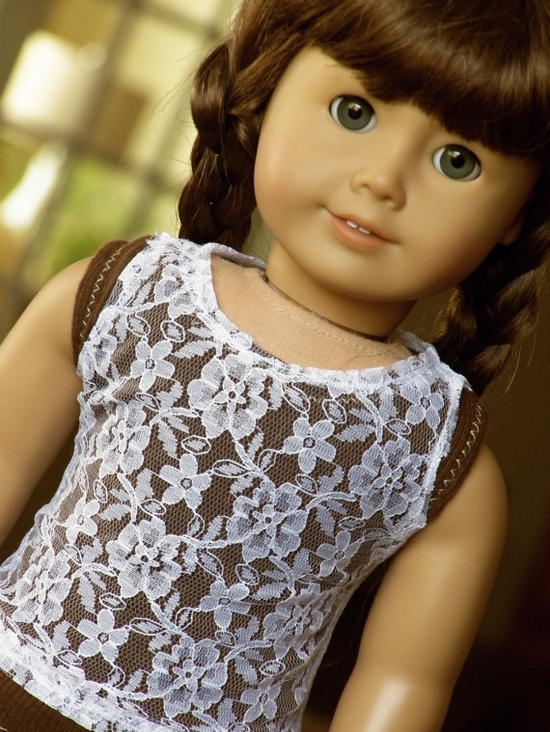 beautiful sturdy white lace tank top for American Girl Dolls. The top consists of a beautiful floral lace design and white stitching and is a perfect addition for any layering (tops, dresses, etc.) or even underlayers-tops that expose or tops that are see through (off shoulder tees, burnout tees, etc.)  Beautifully sewn and has velcro in the back for easy fitting. .