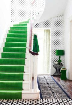 Top Home Decor Trends for 2013: Polka Dots! - The polka dot wallpaper adds sweetness to this foyer with a stunning stairway carpeted in emerald green, which is the Pantone Color of the Year for 2013