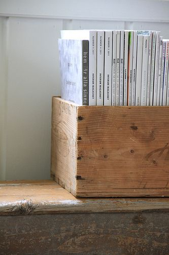 Wooden box filled with magazines