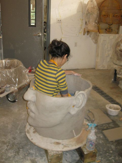 Cristina Córdova, working inside one of her ceramic sculptures.