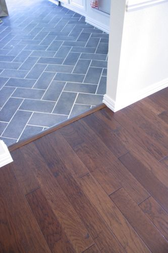 Good idea for wood floor in the living room/ tile around the fireplace