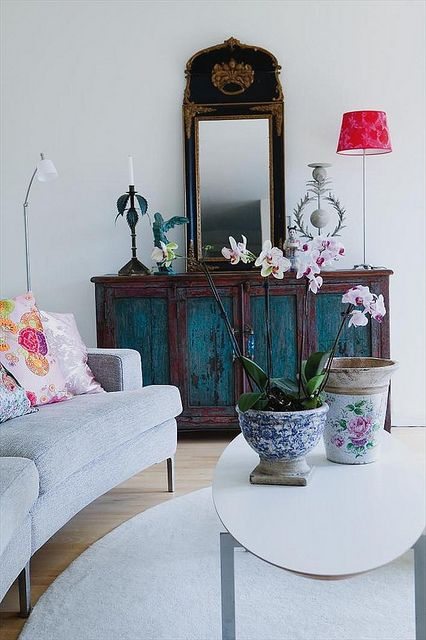 eclectic room...gorgeous painted console!!