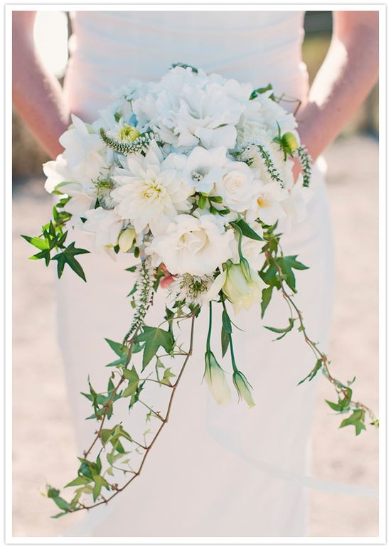 bouquet of white roses, lissianthus, freesia, blue hydrangia and ivy