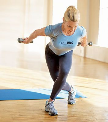 Work your legs, hips, thighs, core AND posture with our Move of the Day: Curtsy Lunge and PressBack